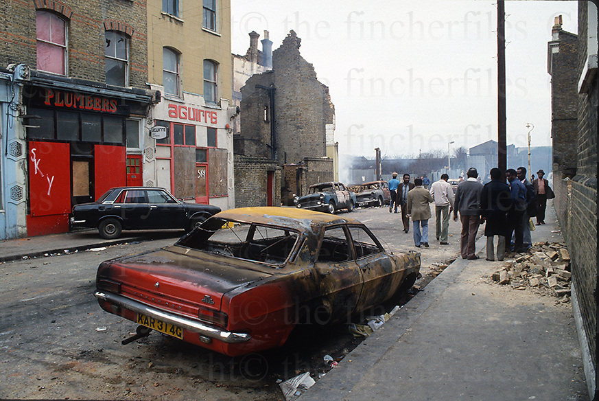 Aftermath of the urban riots on the streets of Brixton,South London in April 1981. Photographed by Terry Fincher