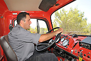 Israel, Carmel Mountain, Shekef Forest, Fire fighter driving a fire engine to extinguish a forest fire started by arson September 12th 2009