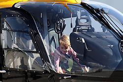 Prince George explores a rescue helicopter as he visits Airbus in Hamburg, Germany with his parents and sister.