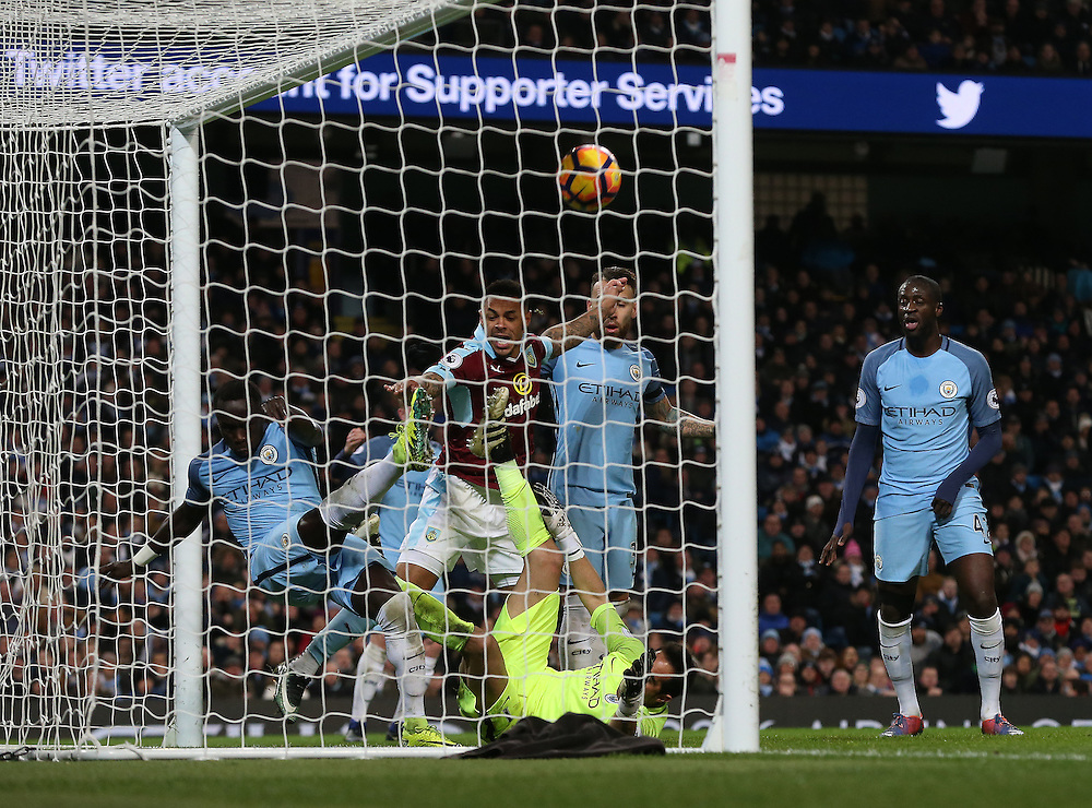 Burnley's Andre Gray scores his sides only goal past Manchester City's goalkeeper Claudio Bravo and Bacary Sagna<br /> <br /> Photographer Rachel Holborn/CameraSport<br /> <br /> The Premier League - Manchester City v Burnley - Monday 2nd January 2017 -  Etihad Stadium - Manchester<br /> <br /> World Copyright © 2017 CameraSport. All rights reserved. 43 Linden Ave. Countesthorpe. Leicester. England. LE8 5PG - Tel: +44 (0) 116 277 4147 - admin@camerasport.com - www.camerasport.com
