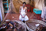 A man selling live chickens in a market in Dhaka Bangladesh
