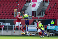 Bristol City's Taylor Moore (23) and Exeter City's Ryan Bowman (12) compete for a high ball during the EFL Cup match between Bristol City and Exeter City at Ashton Gate, Bristol, England on 5 September 2020.
