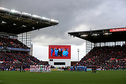 The two team's stand during a minute's silence for Remembrance Day