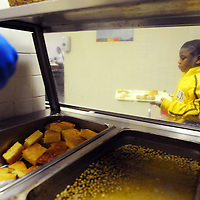 JaJuan gets his dinner from the Salvation Army's dining room.