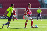 Bristol City's Taylor Moore (23) comes under pressure from Exeter City's Ryan Bowman (12) during the EFL Cup match between Bristol City and Exeter City at Ashton Gate, Bristol, England on 5 September 2020.
