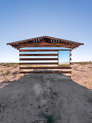 House of mirrors: The incredible cabin in the California desert that appears to be see-through<br /><br />All it took to turn a 70-year-old ramshackle wooden shelter in the California High Desert into an international art phenomenon was a few mirrors, colourful LED lights and a heaping portion of creativity.<br />In mid-October, well-regarded artist Phillip K. Smith III arrived in Joshua Tree, California, to unveil his latest project called Lucid Stead: a mind-bending installation composed of reflecting panels, lights and custom electronic equipment mounted on a humble timber shack.<br />Like the otherworldly lunar landscape, the art piece changed throughout the day.<br />During daytime, the structure appeared ethereal and partially transparent thanks to strategically placed mirrors reflecting the sweeping vistas. By night, square and rectangular fields of color in red, green and blue filled the doors and windows<br />'Lucid Stead is about tapping into the quiet and the pace of change of the desert,' Smith said of his creation. 'When you slow down and align yourself with the desert, the project begins to unfold before you. It reveals that it is about light and shadow, reflected light, projected light, and change.'<br />The installation was initially planned as a two-day event for a few spectators. But thanks to word of mouth and fawning press coverage, it quickly turned into a must-see destination for some 400 arts lovers who traveled from as far as New York and Canada over two weekends in October to catch a glimpse of the incredible transparent house.<br /><br />Those fortunate enough to have seen Lucid Stead in person described the unique structure as a mirage that appeared to be floating above the desiccated desert ground thanks to sleek mirrored planks alternating with gnarly wooden ones.<br />At night, the cabin's windows and doors lit up with LED lights controlled by a computer that gradually changed hues, transforming the appearance of the monochromatic, dull