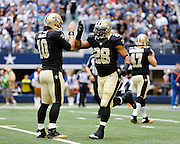New Orleans Saints quarterback Chase Daniel (10) and running back Mark Ingram (28) high-five before kick off against the Dallas Cowboys at Cowboys Stadium in Arlington, Texas, on December 23, 2012.  (Stan Olszewski/The Dallas Morning News)