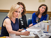 """24 MAY 2019 - WEST DES MOINES, IOWA: US Senator KIRSTEN GILLIBRAND (D-NY), left, chairs a community forum in the West Des Moines Public Library. Gillibrand unveiled her """"Family Bill of Rights"""" during a forum in West Des Moines. The New York Senator has made family health and rights a centerpiece of her campaign. She is touring Iowa this week to support her candidacy to be the Democratic nominee for the US Presidency. Iowa traditionally hosts the the first selection event of the presidential election cycle. The Iowa Caucuses will be on Feb. 3, 2020.           PHOTO BY JACK KURTZ"""