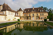 The main chateau building with its tower and a pond showing a reflection Chateau Bouscaut Cru Classe Cadaujac Graves Pessac Leognan Bordeaux Gironde Aquitaine France