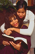 Mother age 45 studying Bible with daughter age 15.  St Paul Minnesota USA