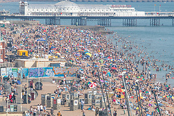 © Licensed to London News Pictures. 09/08/2020. Brighton, UK. Thousands to people take to the beach in Brighton and Hove as the South Coast is being hit by one of the hottest weekends of the year so far with temperatures going well in the 30C's in the South Coast. Photo credit: Hugo Michiels/LNP