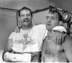 Oakland Raider lineman after tougjh game, Ben Davidson and teammate Dan Birdwell in locker room.<br />(1963 photo by Ron Riesterer)