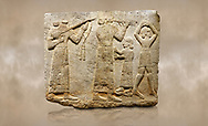 Photo of Hittite monumental relief sculpted orthostat stone panel of Procession. Limestone, Karkamıs, (Kargamıs), Carchemish (Karkemish), 900-700 B.C. Anatolian Civilisations Museum, Ankara, Turkey.<br /> <br /> Musicians. Two musicians with short arms, wearing long dresses and wide belts; one plays a Saz (a stringed musical instrument) with tassels on the handle while the other plays the flute. The third small figure holds castanets (?) in his hands. The figure on the right wears a short skirt, contrary to the others. She dances over her finger tips with her hands over her head. <br /> <br /> Against a brown art background. .<br />  <br /> If you prefer to buy from our ALAMY STOCK LIBRARY page at https://www.alamy.com/portfolio/paul-williams-funkystock/hittite-art-antiquities.html  - Type  Karkamıs in LOWER SEARCH WITHIN GALLERY box. Refine search by adding background colour, place, museum etc..<br /> <br /> Visit our HITTITE PHOTO COLLECTIONS for more photos to download or buy as wall art prints https://funkystock.photoshelter.com/gallery-collection/The-Hittites-Art-Artefacts-Antiquities-Historic-Sites-Pictures-Images-of/C0000NUBSMhSc3Oo