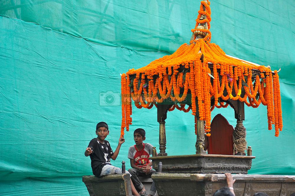 September 15, 2016 - Kathmandu, NE, Nepal - Kid Playing on a chariot of deity on the third day of Indra Jatra Festival celebrated at Basantapur Durbar Square, Kathmandu, Nepal on Thursday, September 15, 2016. Devotees celebrated the god of rain 'Indra' for 8 days in Kathmandu. (Credit Image: © Narayan Maharjan/NurPhoto via ZUMA Press)