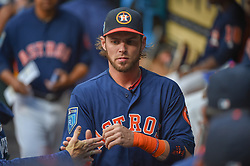 March 26, 2018 - Houston, TX, U.S. - HOUSTON, TX - MARCH 26: Houston Astros outfielder Josh Reddick (22) high fives a teammate during the game between the Milwaukee Brewers and Houston Astros at Minute Maid Park on March 26, 2018 in Houston, Texas. (Photo by Ken Murray/Icon Sportswire) (Credit Image: © Ken Murray/Icon SMI via ZUMA Press)