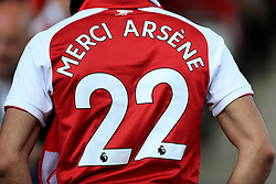 A fan wearing a shirt honouring outgoing manager Arsene Wenger before the Premier League match at the John Smith's Stadium, Huddersfield.