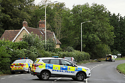© Licensed to London News Pictures. 16/08/2020. Calne, UK. The scene at the A4 at Derry Hill near Calne in Wiltshire where four people have been killed in a road traffic accident in which a car is believed to have hit a house then caught fire.  Photo credit: Tim Ireland/LNP