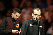 Mark Williams of Wales  in action during his match against Mark Selby (l). . Betvictor Welsh Open snooker 2016, day 4 at the Motorpoint Arena in Cardiff, South Wales on Thursday 18th Feb 2016.  <br /> pic by Andrew Orchard, Andrew Orchard sports photography.