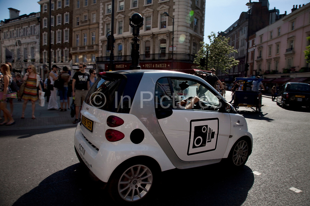 High-tech cars which use a CCTV camera in a periscope to spy on drivers breaking the law are issuing tickets in London. The specially modified Smart cars are being deployed by Westminster council to enforce traffic and parking restrictions in the West End.