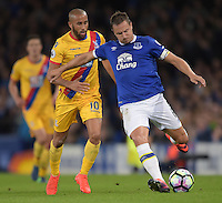 Everton's Phil Jagielka under pressure from Crystal Palace's Andros Townsend<br /> <br /> Photographer Terry Donnelly/CameraSport<br /> <br /> The Premier League - Everton v Crystal Palace - Friday 30th September 2016 - Goodison Park - Liverpool<br /> <br /> World Copyright © 2016 CameraSport. All rights reserved. 43 Linden Ave. Countesthorpe. Leicester. England. LE8 5PG - Tel: +44 (0) 116 277 4147 - admin@camerasport.com - www.camerasport.com