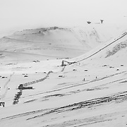 View up Adventdalen from Longyearbyen, Coal dust can be seen on the snow at Mine #7, the only active mine near Longyearbyen