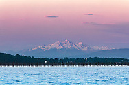Twin Sisters Mountain (Washington State) behind White Rock Pier and Boundary Bay.  Photographed from West Beach in White Rock, British Columbia, Canada.