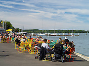 People relax along the shore of Lake Mendota at the Memorial Union, University of Wisconsin-Madison; Madison, Wisconsin
