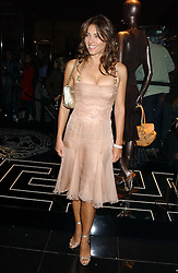LIZ HURLEY at a party hosted by Versace during London Fashion Week 2005 at their store in Slaone Street, London on 19th September 2005.<br />