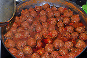 cooking meatballs in tomato sauce