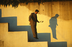 Man leaping down stairs at sunset