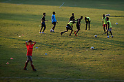 Young male footballers train in Ruskin Park a south London green space, during late afternoon, on 21st September 2021, in London, England.