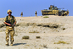 File photo dated 4/11/2004 of a soldier on patrol in the area of Ahmed Al Ahamadi near Camp Dogwood, Iraq. Taxpayers footed a bill of more than £20 million to settle compensation claims against the British military during the Iraq War.
