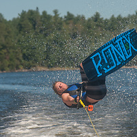 Ben Wiltsie rides a wake board on Lake of the Woods, Ontario, Canada.