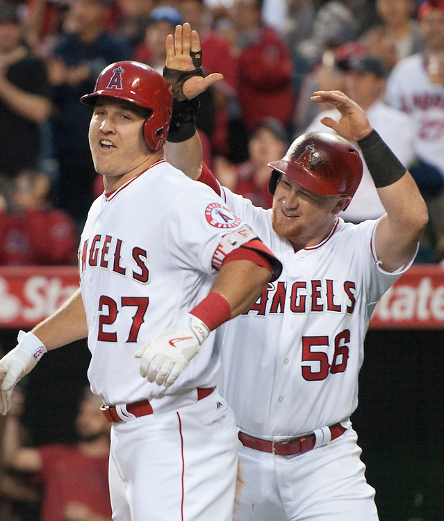 The Angels' Mike Trout celebrates with Kole Calhoun after his three run home run in the second inning against the Detroit Tigers Tuesday at Angel Stadium.<br /> <br /> ///ADDITIONAL INFO:   <br /> <br /> angels.0531.kjs  ---  Photo by KEVIN SULLIVAN / Orange County Register  -- 5/31/16<br /> <br /> The Los Angeles Angels take on the Detroit Tigers Tuesday at Angel Stadium.
