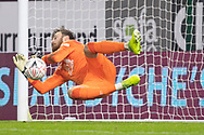 Burnley goalkeeper Will Norris (25) save a penalty form Milton Keynes Dons midfielder Ben Gladwin (7) during the FA Cup match between Burnley and Milton Keynes Dons at Turf Moor, Burnley, England on 9 January 2021.