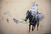 Graffiti on a wall in the area of Kolonaki. Kolonaki is a wealthy, chic and upmarket district, and a fashionable meeting area. As one of the capital's leading shopping areas, it includes a number of high-end boutiques from young adult to casual fashion to prestigious haute couture from Greek and international designers. Visitors to Athens can't help but notice the amount of graffiti in the city. Any surface that can be sprayed upon is covered with a maddening number of signatures and designs. Beautifully restored neo-classic houses from the late 19th Century usually have a few days or weeks before they are covered in graffiti and owners find themselves in a war that they eventually lose and surrender to the kids. Graffiti in Athens is as old as the city itself. In ancient times graffiti was carved into buildings, in fact the word comes from the Greek graphi which means to write. The most disturbing aspect of the graffiti besides the volume of it, is the way some of the kids whose artistic ability begins and ends with their names (tags), have defaced some of the real works of art. Athens is the capital and largest city of Greece. It dominates the Attica periphery and is one of the world's oldest cities, as its recorded history spans around 3,400 years. Classical Athens was a powerful city-state. A centre for the arts, learning and philosophy.
