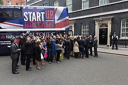 © Licensed to London News Pictures. 23/06/2015. London, UK. Entrepreneurs welcome DAVID CAMERON at the launch of the Start-Up Britain campaign routemaster bus in Downing Street, London with Prime Minister, David Cameron. Over five weeks the routemaster bus will visit 30 towns and cities - including Aberdeen, Inverness, Swansea York and Leeds - and aim to engage with 15,000 individuals through workshops and networking events, making them aware of the assistance Start-Up Britain can offer. Photo credit : Vickie Flores/LNP