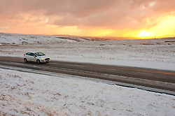 © Licensed to London News Pictures. 11/03/2019. Mynydd Epynt, UK. A motorist drives along the B4520 between Brecon and Builth Wells through a wintry landscape on the Mynydd Epynt moorland in Powys, Wales, after snow fell on high land in Powys. Photo credit: Graham M. Lawrence/LNP