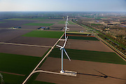 Nederland, Flevoland, Zeewolde, 01-05-2013; Wind farm De Zuidlob. Het windmolenpark (windpark) is een initiatief van  lokale agrariers / boeren en Nuon - Vattenfall . .In de achtergrond het Horsterwold met deelgebied De Stille Kern..The wind farm in the polder Flevoland is an initiative of local farmers and Nuon - Vattenfall. On the other side of the motorway an recently planted deciduous forest..Luchtfoto (toeslag op standard tarieven).aerial photo (additional fee required).copyright foto/photo Siebe Swart