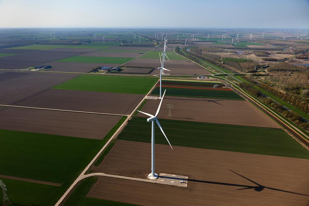 Nederland, Flevoland, Zeewolde, 01-05-2013; Wind farm De Zuidlob. Het windmolenpark (windpark) is een initiatief van  lokale agrariers / boeren en Nuon - Vattenfall . .In de achtergrond het Horsterwold met deelgebied De Stille Kern..The wind farm in the polder Flevoland is an initiative of local farmers and Nuon - Vattenfall. On the other side of the motorway an recently planted deciduous forest..Luchtfoto (toeslag op standard tarieven).aerial photo (additional fee required).copyright foto/photo Siebe Swart