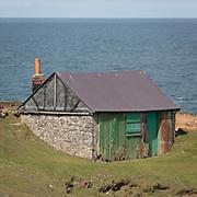 Abandoned fishing hut at Porth Ysgaden, Llŷn Peninsula, Gwynedd.