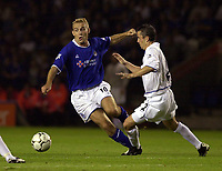 Photo: Greig Cowie.<br /> 15/09/2003.<br /> Barclaycard Premiership. Leicester City v Leeds United, The Walkers Stadium.<br /> James Scowcroft puts preassure on Gary Kelly