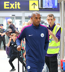 Fernandinho as the Manchester City team arrive at Manchester Airport as they jet for Iceland