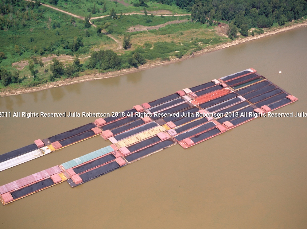 Aerial view of Barges of Coal sailing up the Mississippi River outside New Orleans