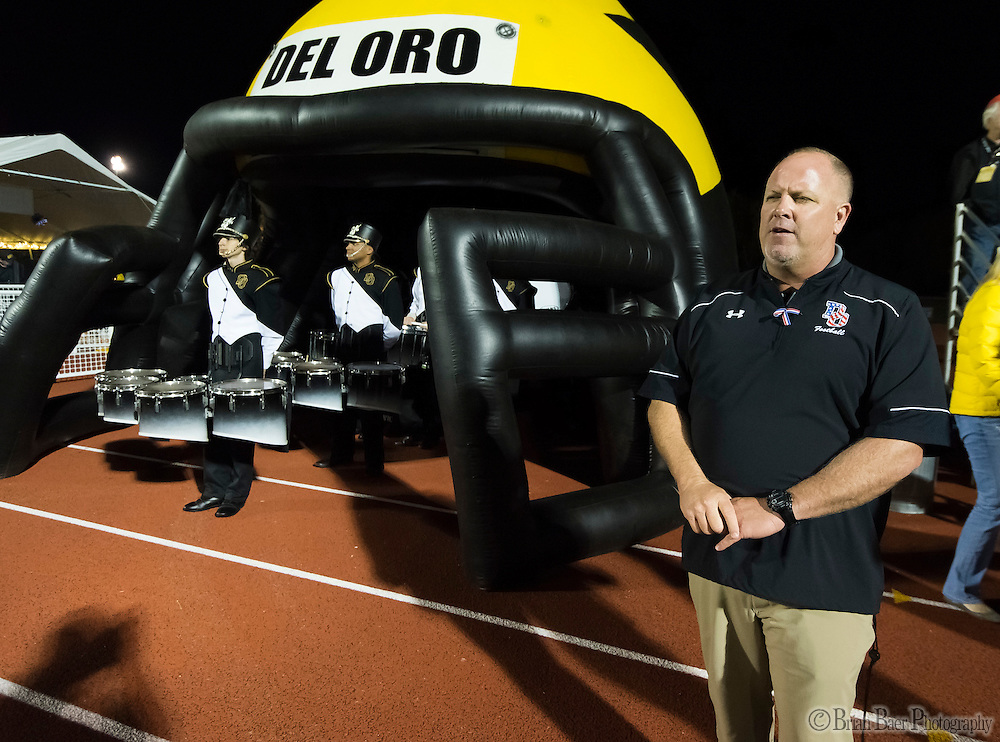 Del Oro Golden Eagle's head coach Casey Taylor,  waits to take the field with his team before the game as the Del Oro Golden Eagles varsity football team host the Oak Ridge Trojans, Friday Oct 21, 2016.<br /> photo by Brian Baer