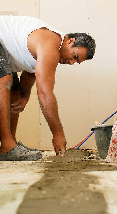 skilled plasterer at work