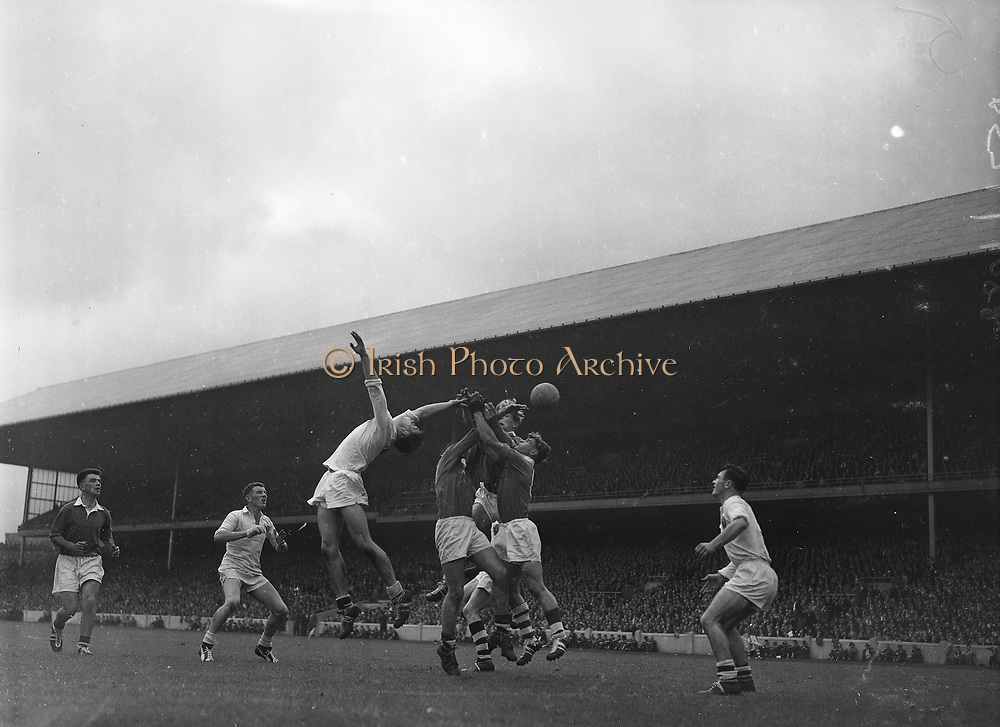 GAA All Ireland Minor Football Final Cork v. Galway 26th September 1960 Croke Park<br /><br />Cork forwards, D. Moynihan, Coughlan and L.O'Hanrahan tussel among themselves for possession of the ball near Galway Goal. Galway full back N. Tierney jumps backwards on left and Galway goalie S. Smyth watches anxiously on the right *** Local Caption *** It is important to note that under the COPYRIGHT AND RELATED RIGHTS ACT 2000 the copyright of these photographs are the property of the photographer and they cannot be copied, scanned, reproduced or electronically stored in any form whatsoever without the written permission of the photographer  26th September 1960<br /> <br /> All Ireland Minor Football Final between Cork and Galway at Croke Park.