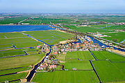 Nederland, Noord-Holland, gemeente Castricum, 20-04-2015; het dorp De Woude gelegen aan de Markervaart op een eiland in het Alkmaarder- en Uitgeestermeer.<br /> Small village on island in Alkmaardermeer.<br /> luchtfoto (toeslag op standard tarieven);<br /> aerial photo (additional fee required);<br /> copyright foto/photo Siebe Swart