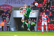 Herbie Kane of Doncaster Rovers (15) heads above Liam Kelly of Coventry City (6) during the EFL Sky Bet League 1 match between Doncaster Rovers and Coventry City at the Keepmoat Stadium, Doncaster, England on 4 May 2019.