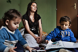 "Veronika Sindelárová watches her children, right to left,  Rinaldo Gina, 2, and Fabián Gina, 1, in their home in Ostrava, Czech Republic on March 1, 2012. Veronika was one of 18 Roma children who were represented in the D.H. and Others v. Czech Republic case, the first challenge to systemic racial segregation in education to reach the European Court of Human Rights. When this case was first brought in 2000, Roma children in the Czech Republic were 27 times more likely to be placed in ""special schools,"" intended for the mentally disabled, than non-Roma children. In 2007, the Grand Chamber of the European Court of Human Rights ruled that this pattern of segregation violated nondiscrimination protections in the European Convention on Human Rights. Despite this landmark decision, little change has occurred: the ""special schools"" have been renamed but follow the same substandard curriculum and Roma continue to be assigned to these schools in disproportionate numbers. The process of integration has barely begun."